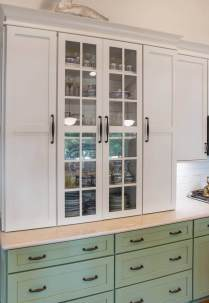 Two Toned Medallion cabinetry with oil rubbed bronze decorative hardware.