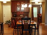 Kitchen with Built-in Curio Cabinet in Williams Bay - dining-room-640x480_c