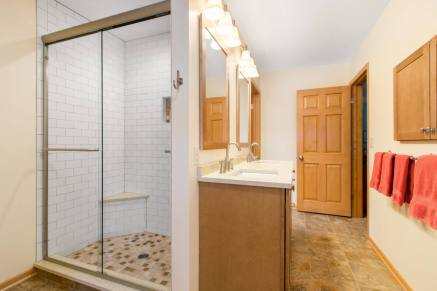 Master Bathroom Remodel with Maple Cabinetry and matching 6 panel maple door
