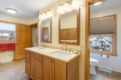 Custom maple double vanity has Caesar Stone quartz counter tops.