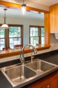 Kitchen gets new laminate, Kohler sink and Delta faucet