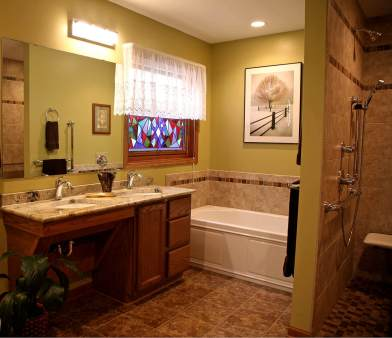 Bathroom receives a whole new more easily accessible layout.