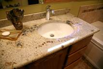 Existing vanity gets new sinks and a new granite top.