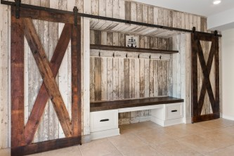 Charming area featuring reclaimed barn board provides ample storage