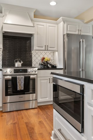 Bosch stainless steal appliances complete this clean modern kitchen look.