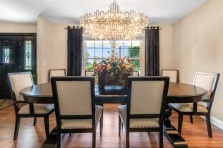 Gorgeous gold chandelier adds elegance to this dining room