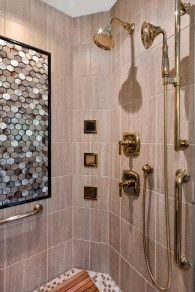 Multiple shower heads in large luxury shower offers a spa oasis for homeowners.