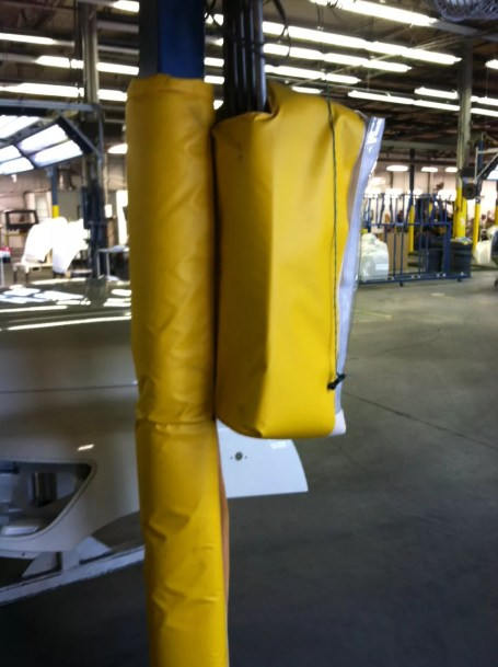 Custom Bollard Cover & Post Sleeve Inside Truck Manufacturing Facility