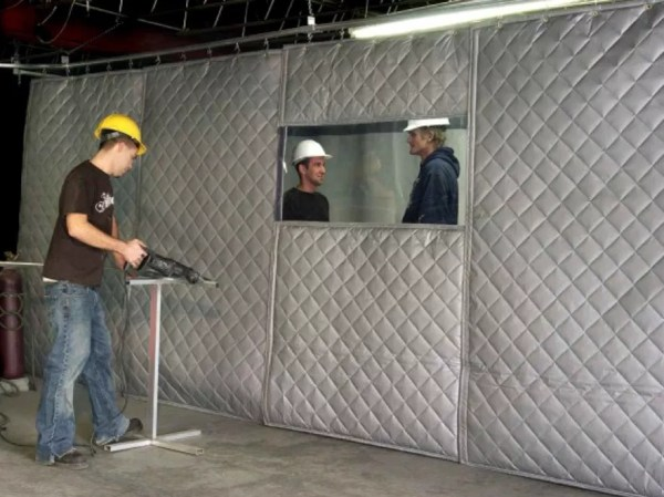 workers using sound absorbing curtains