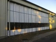 Outdoor Industrial Curtains Provide Temperature Control to Exterior Warehouse Walls.