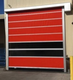 Plastic Roll Up Door in Red & Black on Exterior of Warhouse