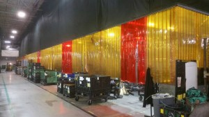 Custom Welding Strip Curtain with Orange and Bronze Strips and Upper Valance Panel Enclosing Large Welding Operation