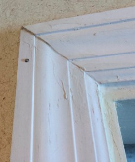 The upstairs bannister railing had likewise been carelessly painted and improperly prepared prior to paint.