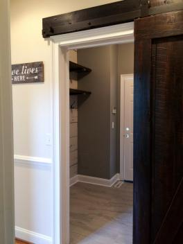 The barn door opens from the main living space into the mudroom/laundry room.