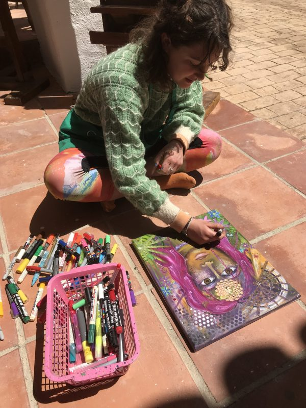 Having fun painting outside in the sunshine