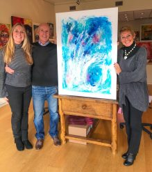 Happy clients with their abstract seascape painting