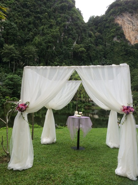 Flowy drapes at a pavilion for the solemnisation ceremony make it much more romantic than just signing papers at the Registry of Marriage!