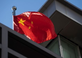 """HOUSTON, TX - JULY 22: A Chinese national flag waves at the Chinese consulate after the United States ordered China to close its doors on July 22, 2020 in Houston, Texas. According to the State Department, the U.S. government ordered the closure of the Chinese consulate """"in order to protect American intellectual property and Americans' private information."""" (Photo by Go Nakamura/Getty Images) Photographer: Go Nakamura/Getty Images North America"""
