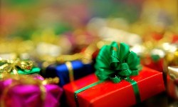 A pile of brightly-wrapped Christmas presents
