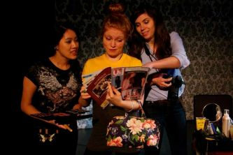 "Stephanie Cho, Natasha Wehn and Tracy Schut as the Photoshoot Team in ""Hamlet"""