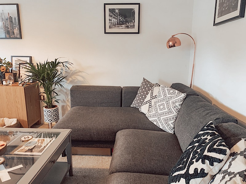 Corner sofa with cushions and a lamp