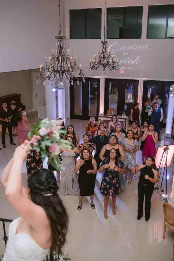 Bouquet toss at Thistlewood manor & gardens wedding