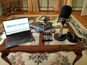 Neumann TLM102 mic, desktop mic stand, Aokeo mini mixer, Sony MDR7506 headphones, windscreen, USB output to laptop.