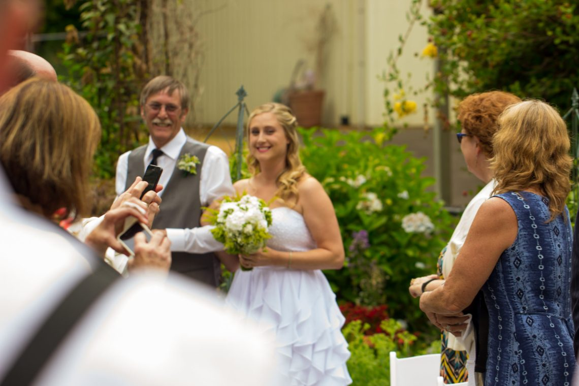 Cruz Ceremony 74 WOODINVILLE BACKYARD POOL WEDDING | WOODINVILLE WEDDING PHOTOGRAPHER