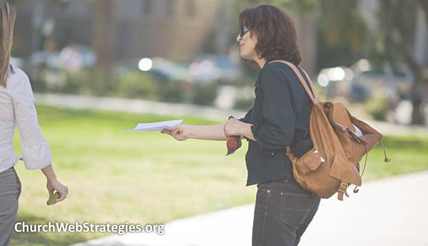 Woman handing out flyers