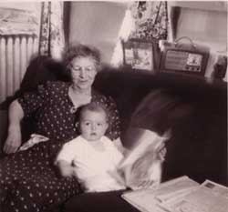 infant Bob on his grandmother' knee, with newspapers