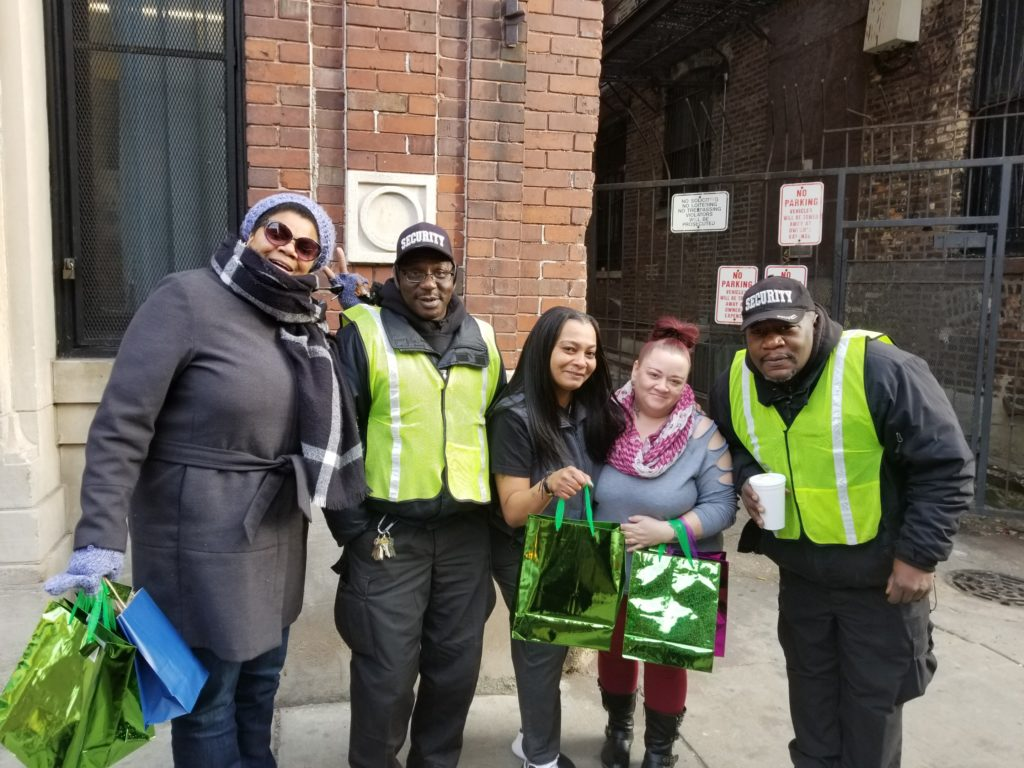 Handing out swag bags to families in need at local Chicago shelter