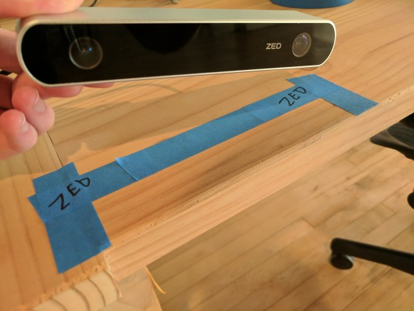 Marking a table with tape where you should set the ZED