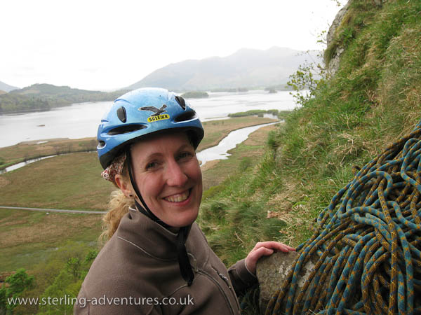 Rebecca at the first belay of Fisher's Folly with a rapidly deteriorating view of Skidaw behind