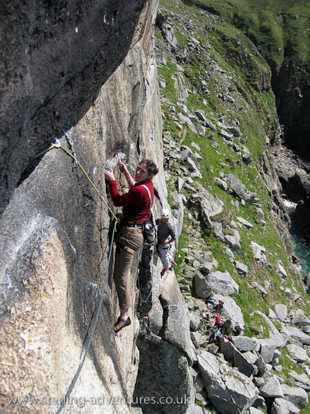 Laetitia on the famous Suicide Wall traverse, with Jon waiting to climb on the 1st belay behind