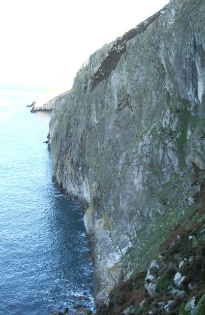 Gogarth Main Cliff, showing part of the approach slope, with a washed out North Stack in the background.