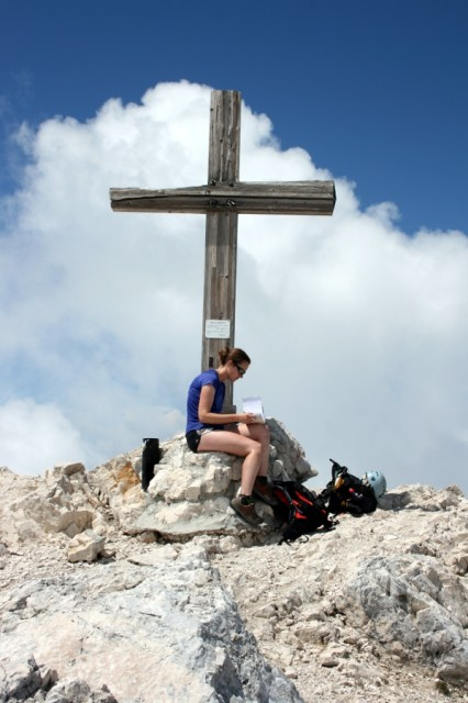 Rachel fills in the log book at the summit of Kanin.