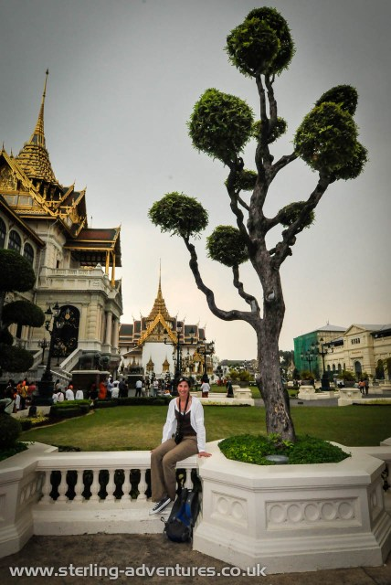 Laetitia takes a break from the crowds and heat under the weird topiary at Phra Thinang Chakri Maha Prasat.