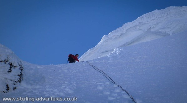 Laetitia approaching the cornice at the top of Left Twin