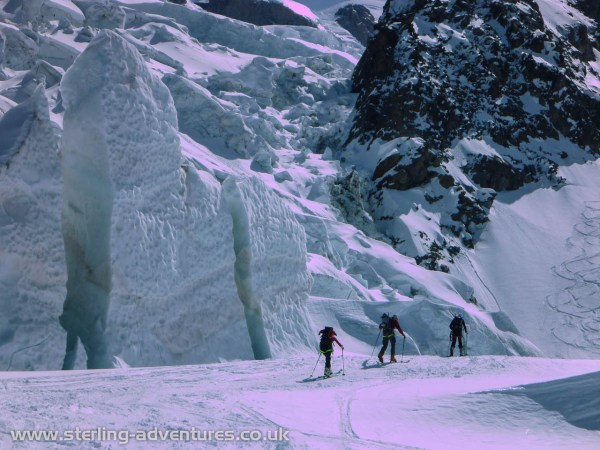 Laetitia, Pete, and Chris passing some enormous ice features in the Bossons Glacier