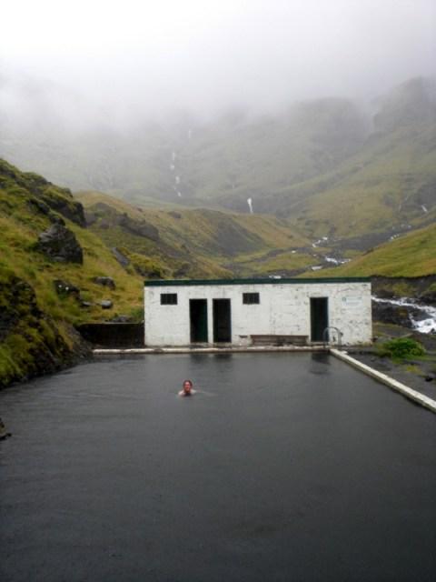 Swimming in the thermal pool at Seljavellir.