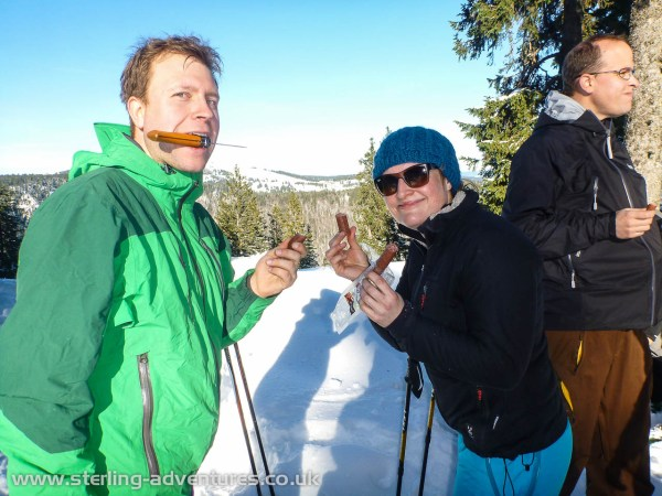 Thorsten and Mina enjoying a slice of sausage on top of the Spießhorn!  :yum: :yum: