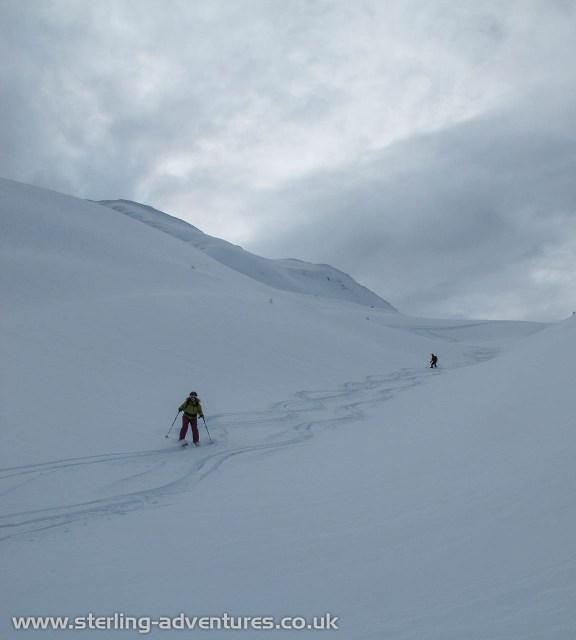 Rebecca and Mathias skiing down towards Trient
