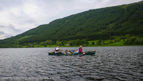 Paul and Lisa paddling west on Loch Voil to find Friday night's campsite...