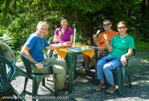 Ian, Laetitia, Pete, and Anna enjoy a well earned ice-cream (beer for Ian) in the sun after the via ferrata adventure