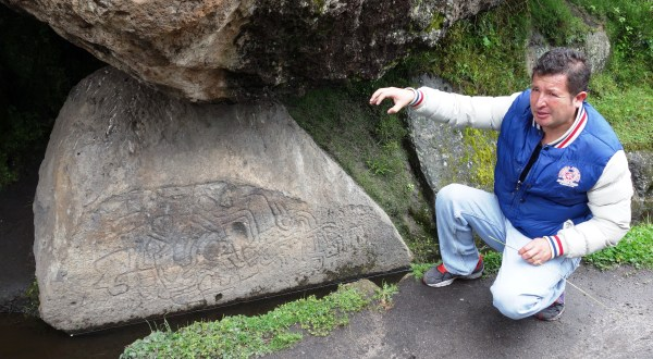 Our guide pointing out the petroglyphs