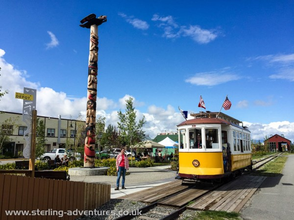 Laetitia poses as the Whitehorse river front electric trolley bus passes by