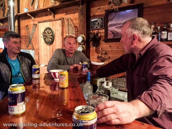 The bar at Inconnu Lodge - Warren briefing Ted and Steve about the next leg of the journey, the flight to Glacier Lake