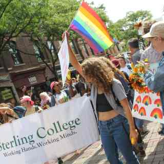 Sterling students carry signs and smile at the Burlington Pride parade