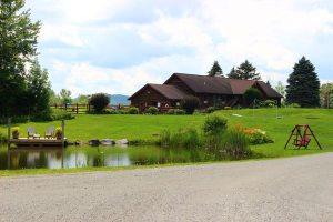 sterling Ridge Resort pond, flowers, and landscape