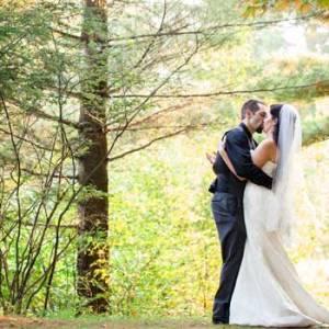 wedding couple with fall foliage | Sterling Ridge Resort
